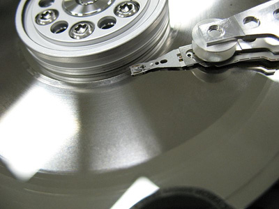 This is a close up picture of the Read-Write Head floating over a healthy Hard Disk Platter.