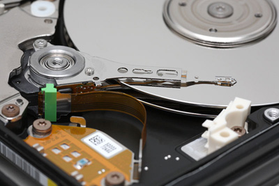 Inner workings of healthy Hard Disk Drive. Look at the perfect condition of the Hard Disk Platters.